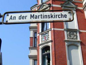 Haus an der Martinskirche mit Lindener Wappen